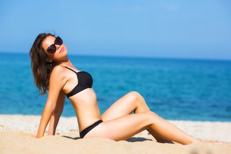 Beautiful young girl on the beach photo