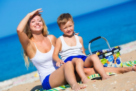 Mother with son on the beach photo