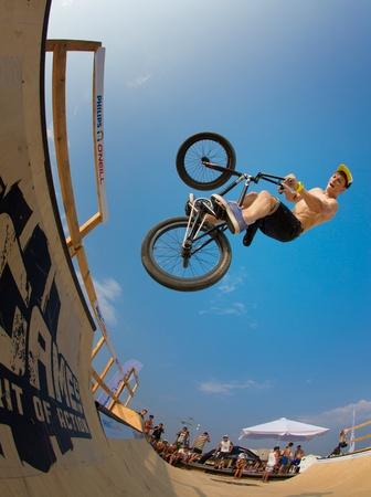 POPOVKA, UKRAINE - AUGUST 14. Racer Anton Evstifeev on\ competition of BMX \
