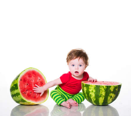Little boy with watermelon isolated on white Zdjęcie Seryjne