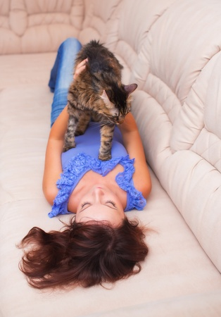 Beautiful young woman at home with cat Stock Photo - 22087504