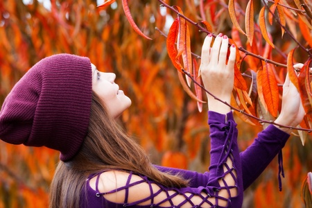 Young woman in autumn peach garden photo