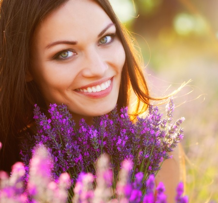 Woman on lavender field portrait photo