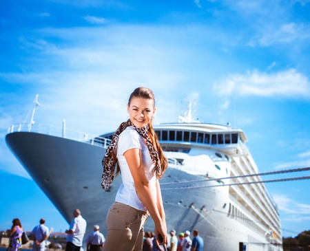Young woman ready to travel on cruise ship Imagens