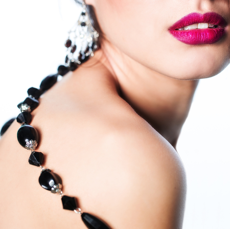 Woman studio portrait with black necklace photo