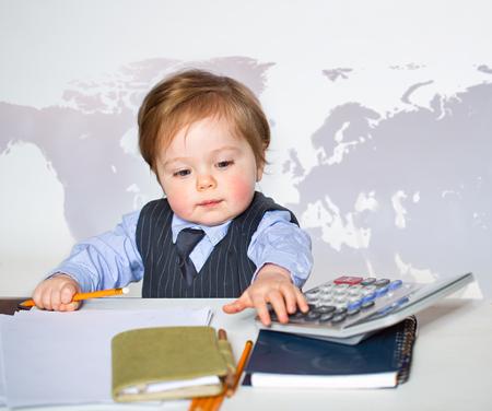 baby cute: Little businessman portrait in office