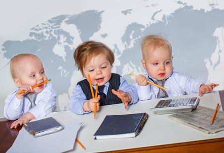 Three little businessman portrait in office photo