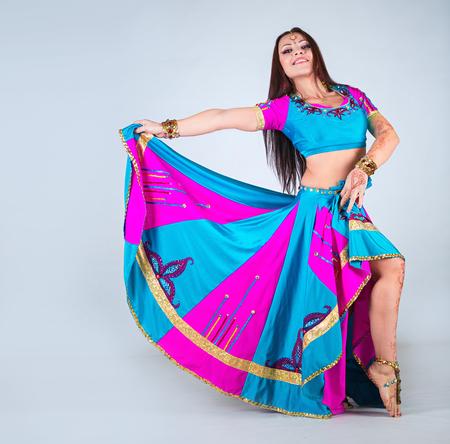 aciculum: Indian woman dancing in national clothes