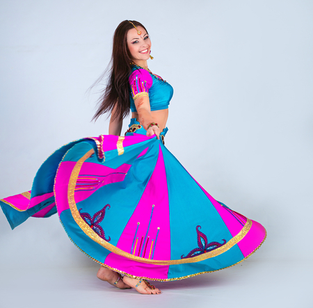 Indian woman dancing in national clothes photo