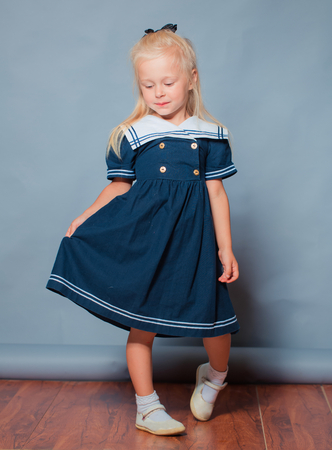 Little beautiful girl portrait in studio photo