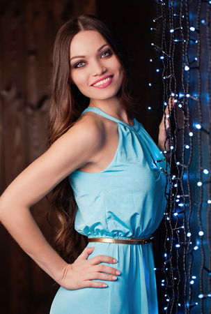 Beautiful girl with long hair portrait near led decorated wall Stock Photo