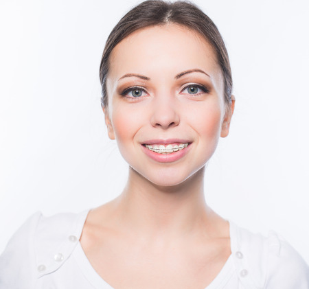 dental health: Beautiful young woman with teeth braces Stock Photo