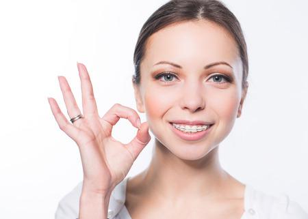 teeth braces: Beautiful young woman with teeth braces Stock Photo