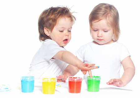 paints: Children playing with finger paints