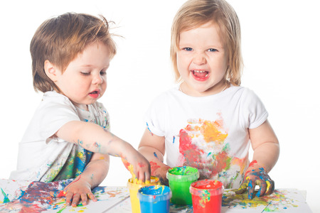 children playing: Children playing with finger paints