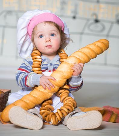 bred: Little boy eating bred in bakery