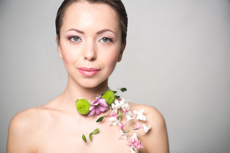 nacked: Beautiful woman with flowers on the showlder. Stock Photo