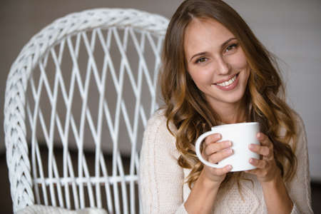 latte: Girl portrait with cup of coffee at home