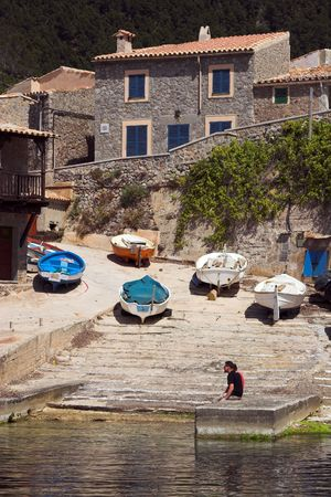 slipway: Fishing village with boats and slipway viewed from across the habour Stock Photo