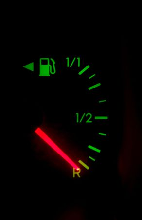 Fule meter of a car shows empty photo