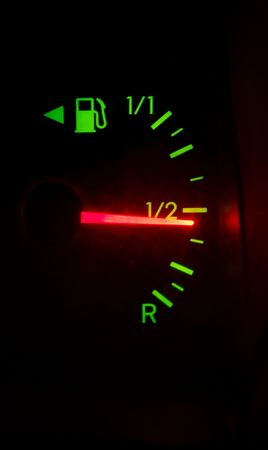 Fuel meter of a car shows half photo