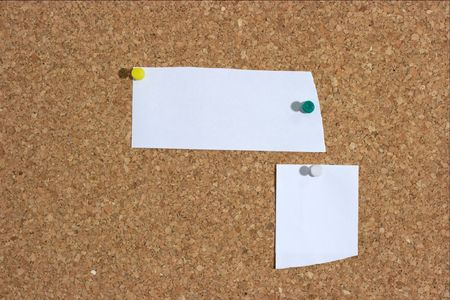 Two white pieces of paper pinned to a board. You can add your own text photo