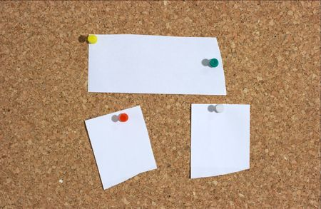 Three pieces of paper pinned to a messageoard. Add your own text! photo