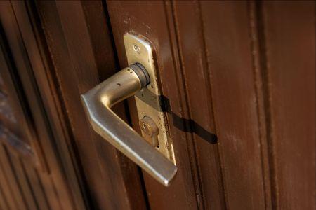 Handle of a dark, wooden door Stock Photo - 616466