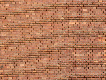 simple Wall of many small brown bricks photo