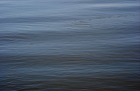 Dark, waving water surface of a river Stock Photo - 616493