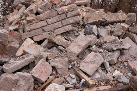 Pile of debris of a ruined building photo