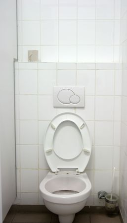piddle: Toilet inside, one seat, white wall, tiles