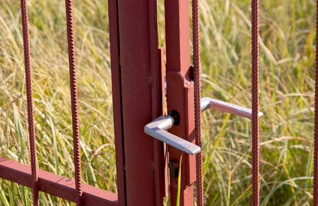 unclosed: Unclosed old, abandoned gate in high grass