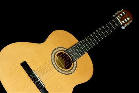 Neck and head of an acoustic guitar, isolated black background with copy-space Stock Photo - 664689