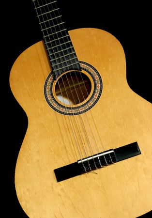 inlays: Neck and head of an acoustic guitar, isolated black background with copy-space