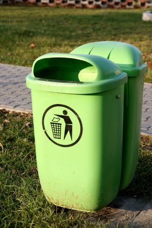 Green dustbin on the street next to the pavement Stock Photo - 708394