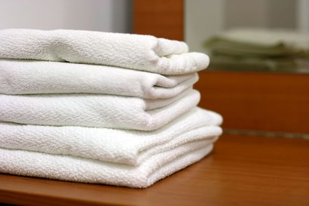 piled: Clean white towels piled up an a table