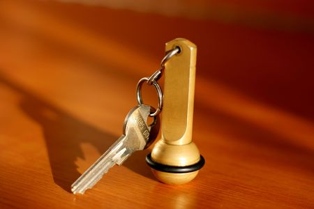 accommodation space: Key of a hotal room on a table