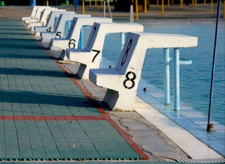 strat: Outdoor swimming pool with eight starting blocks