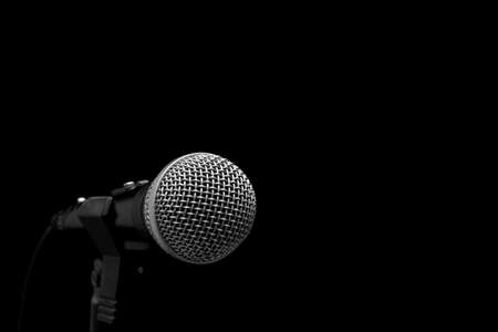 Dynamic microphone on stand isolated on black Stock Photo - 750041