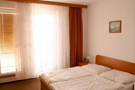 Hotel room with white walls and bright window