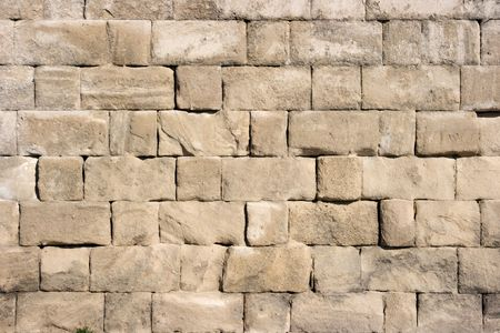 Closeup of a very old stone wall photo