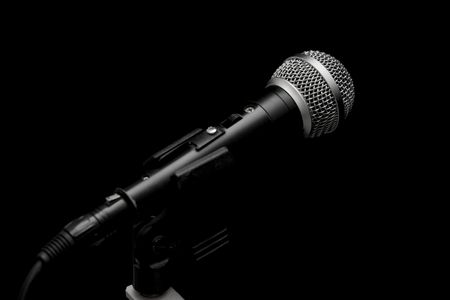 Closeup of a dynamic microphone isolated on black Stock Photo - 794726