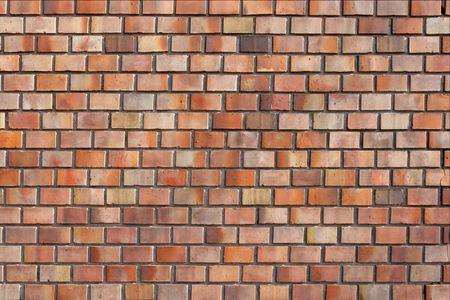 Simple brick wall with tiny reddish bricks photo
