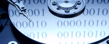 Internals of a hard drive with binary code reflection photo