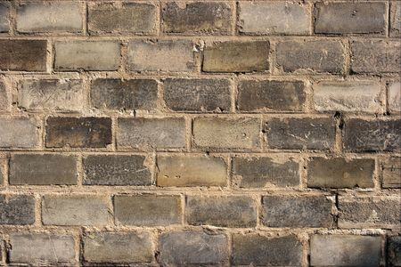 Detailed closeup of a dark gray brickwall photo