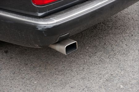 steam output: closeup of the exhaust pipe of a car
