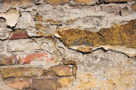 falling apart: Old brickwall falling apart, rough texture closeup