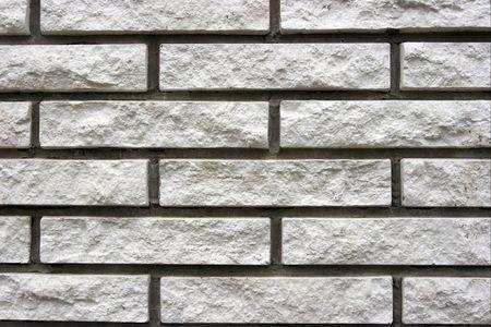 Closeup of a brick wall made of white bricks photo