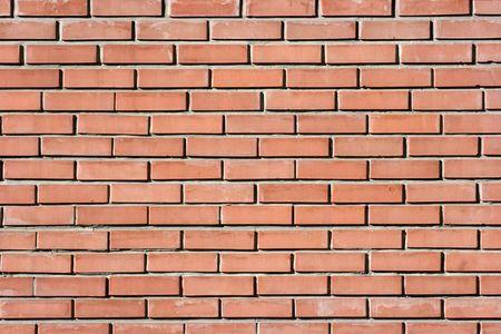 Simmple brickwall with small reddish bricks photo
